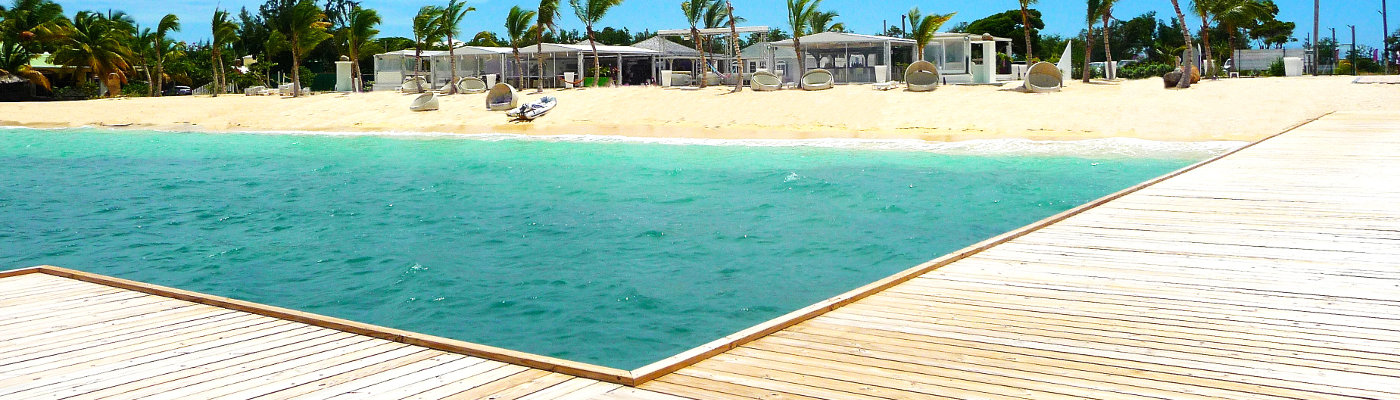 White beach houses with jetties on Caribbean Island
