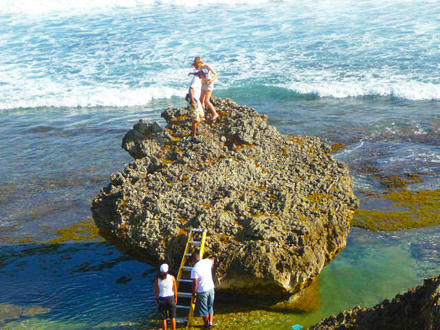 Massive rock in Caribbean sea , location for Avon television commercial shoot