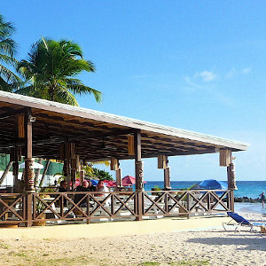 Open beach bar location on white palm beach in the Caribbean