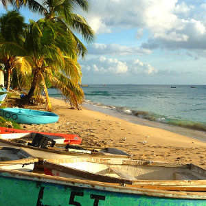 Fishing village beach location on Caribbean Island with wooden row boat props