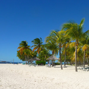 Palm Island beach location with white Caribbean sand