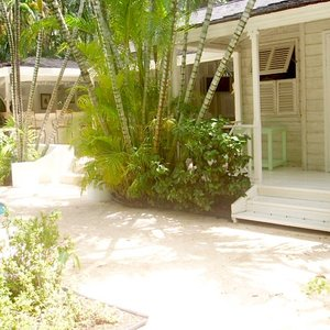 Tropical colonial white wood house veranda location