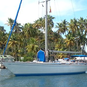 Sailboat with wooden deck on Caribbean palm island shooting location