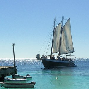 Schooner with white sails for photo shoot rentals on Caribbean sea location