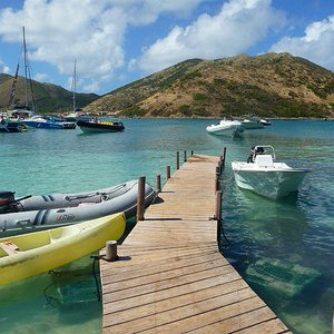 Wooden jetty on small deserted island location near St. Martin