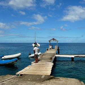 Weather beaten wooden jetty with hut on Caribbean pirates island of  St.Vincent
