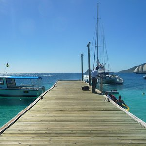 Rustic wooden pier for Caribbean sailing boats
