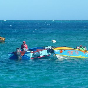 Fishing boats with fishermen, Grenadine sea location