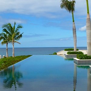 Modern infinity pool bar location in Anguilla