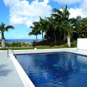 Square swimming pool on veranda of modern villa on Caribbean Island