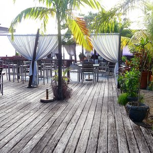 Weather beaten wooden deck location in the Caribbean