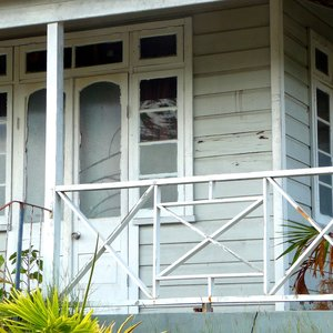 Small Caribbean wood house veranda with patina on location in Barbados
