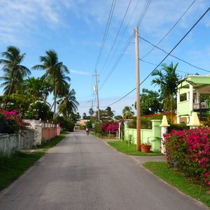 Colorful flower lined street in Caribbean village