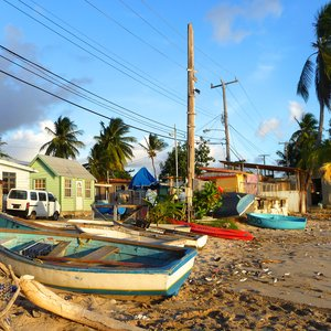 Fishing village with Caribbean wood houses along busy beach side street