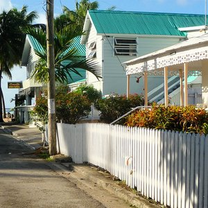 Picked white fence along street location in Barbados